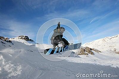 Grabbing Snowboarder