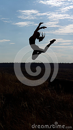 Graceful acrobatic woman leaping