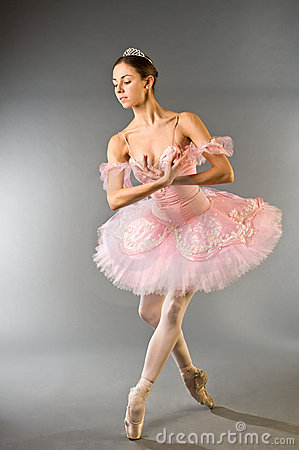 Graceful ballerina dancing isolated