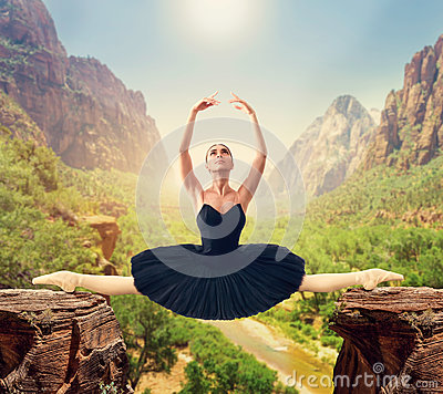 Free Graceful Ballerina Sit On The Twine Over The Gorge Stock Photo - 86256970
