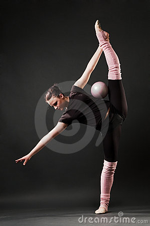 Graceful dancer with ball