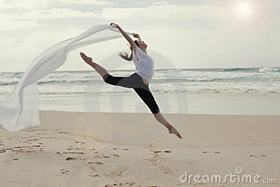 Graceful dancer on beach