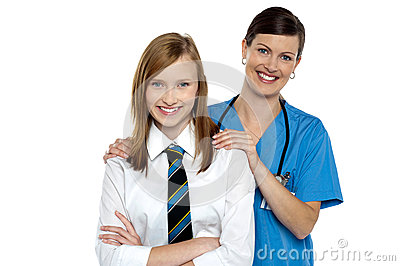 Graceful doctor posing with her teenage patient