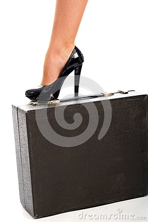 Graceful female leg on attache case