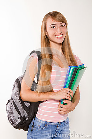 Graceful female student with books in hands