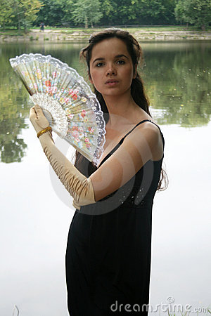 Graceful girl with a fan