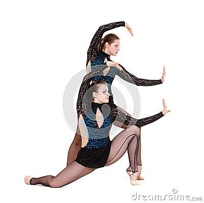 Graceful gymnasts dancing