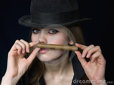 Graceful lady in black and a cigar