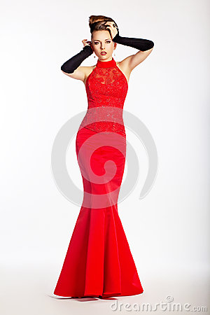 Graceful newlywed in red dress. Luxury