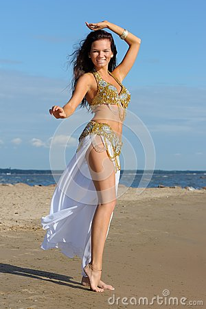 Graceful woman in exotic dress