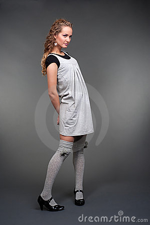 Graceful woman in grey dress
