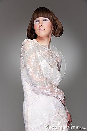 Graceful woman in guipure dress