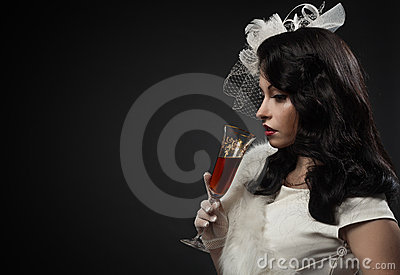 Graceful woman holding glass of wine