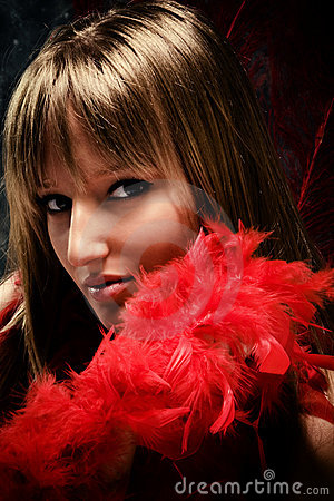 Graceful woman with red plumage portrait