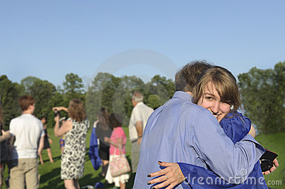 Graduate hugs her dad after commencement