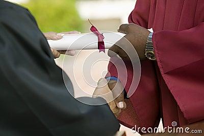 Graduate Receiving Diploma and Handshake