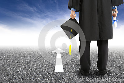 Graduate standing on the road