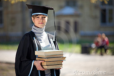 Graduate of university with books
