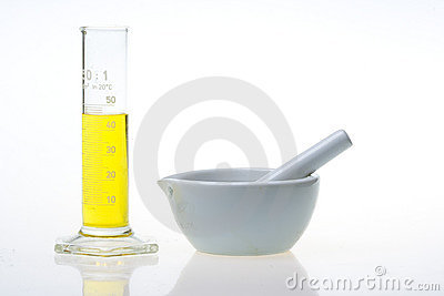 Graduated Cylinder And Grinding Mortar Royalty Free Stock Images - Image: 5112299