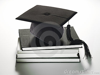 Graduation hat on books