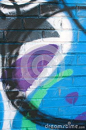 Graffiti Covers Warehouse Brick Wall