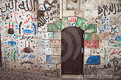 Graffiti on the wall in the Arab block of old city