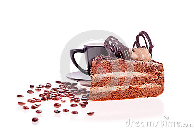 Grain coffee scattered,a cup and a piece of cake