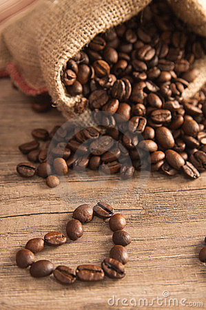 Free Grains Of Coffee On A Wooden Surface Royalty Free Stock Image - 24150266