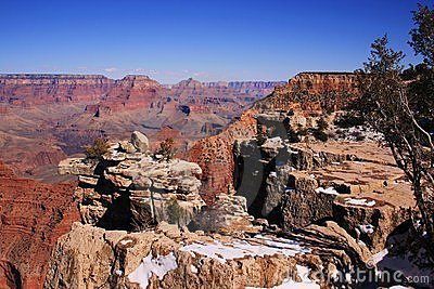 Grand Canyon, AZ, USA; snow on rocks; March