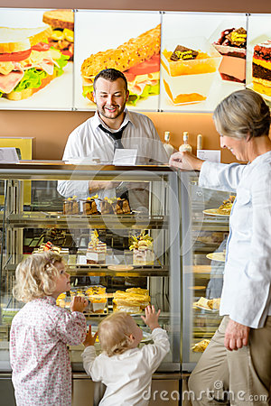 Free Grandchildren Asking Grandmother For Cakes At Cafe Stock Images - 26592334