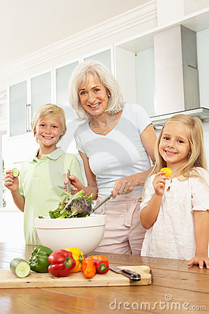 Grandchildren Helping Grandmother To Prepare Salad