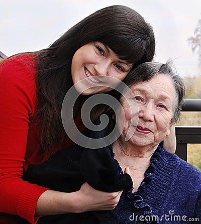 Granddaughter comforting grandmother