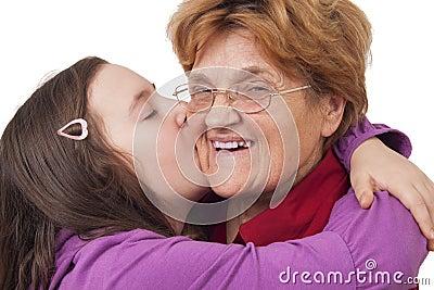 Granddaughter kissing grandmother