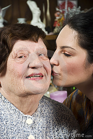 Free Granddaughter Kissing Her Grandmother Royalty Free Stock Photography - 12916487