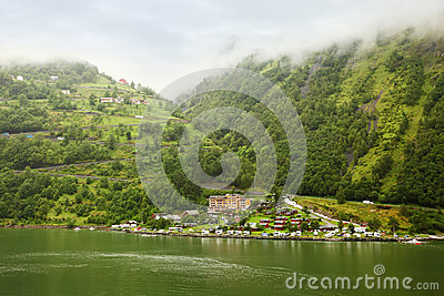 Grande Fjord Hotel and mountain in fog Editorial Photography