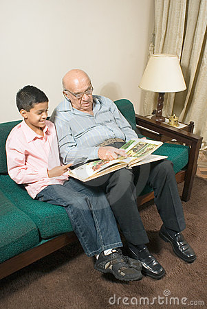 Free Grandfather And Grandson Sit On Couch - Vertical Royalty Free Stock Image - 5479496