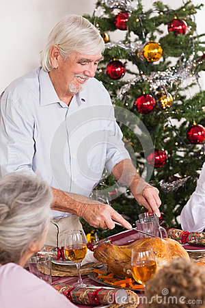 Grandfather Carving Turkey At Christmas Royalty Free Stock Images - Image: 27803989