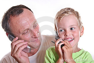 Grandfather and child with phones