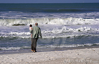 Grandfather and grandson at beach