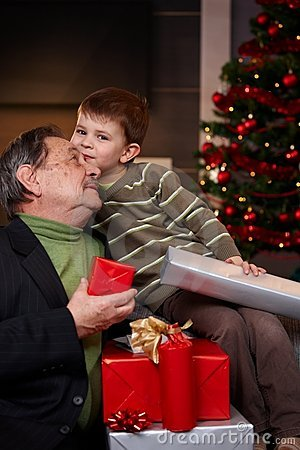 Grandfather and grandson with christmas presents