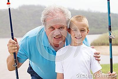 Grandfather grandson fishing