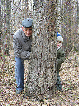 Grandfather and grandson play hide-and-seek