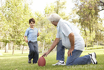 Grandfather And Grandson Playing American Football