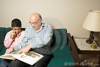 Grandfather and grandson sitting a couch-Hori
