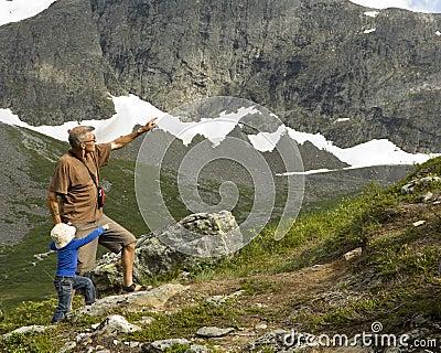 Grandfather and grandson trekking
