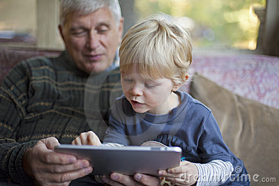 Grandfather and grandson using Tablet PC