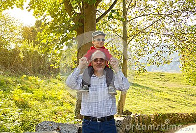 Grandfather holding grandchild on his shoulders