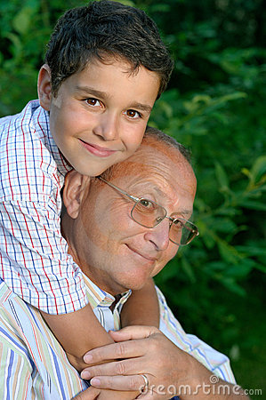 Grandfather and kid outdoors
