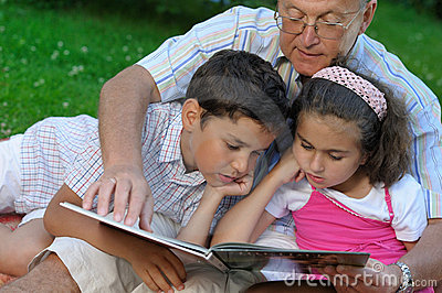Grandfather and kids outdoors