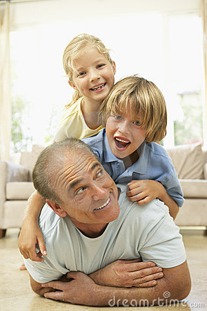 Grandfather Playing With Grandchildren At Home